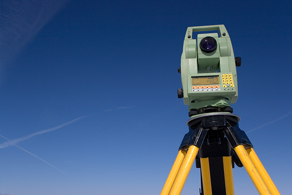 An image of some survey equipment with a blue sky behind it