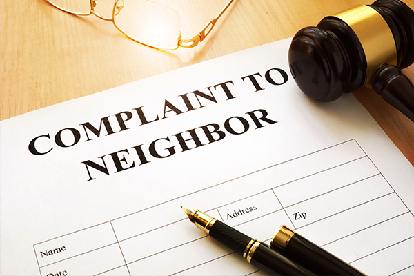 An image showing a court order showing a neighbors complaint